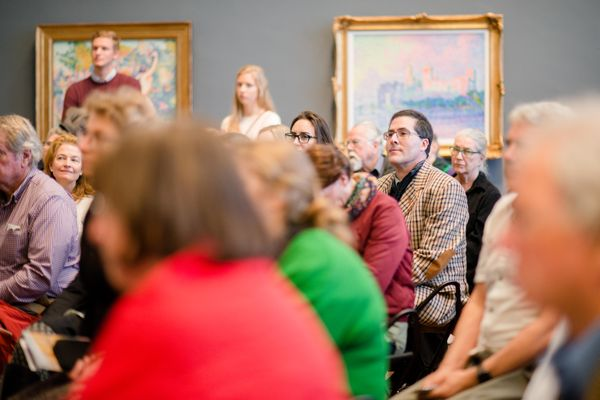Group of Gallery visitors listening to a talk.